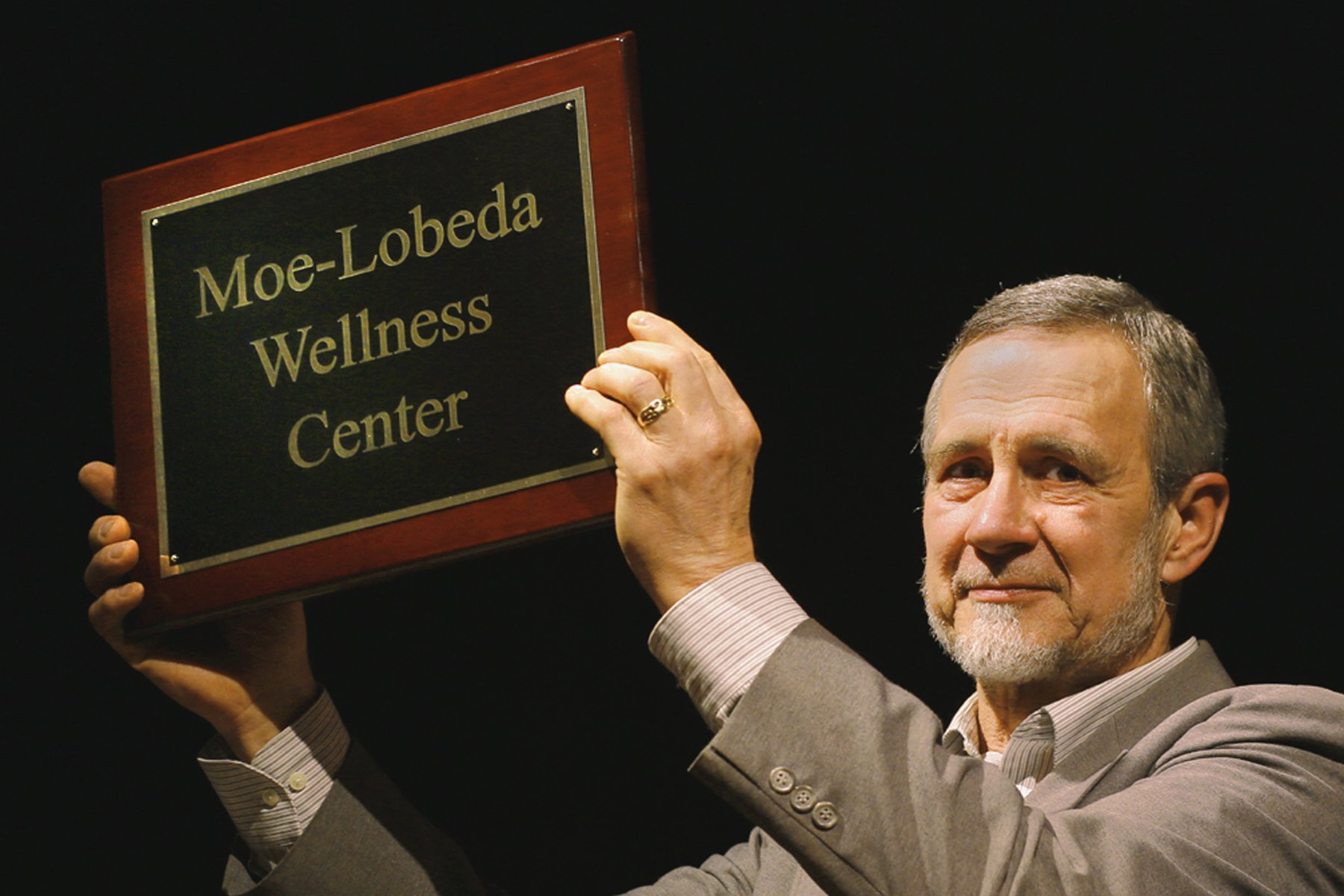 Ron holding up plaque web small